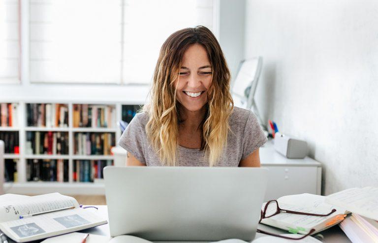woman tutor smiling at computer